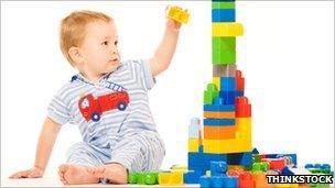 boy building tower
