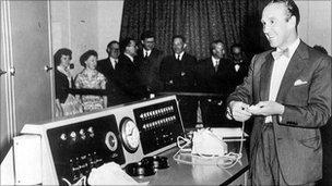 Ernie choosing Premium Bond winners in 1957