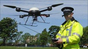 Police officer operating an unmanned aerial system