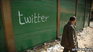 A shop in Tahrir Square is spray painted with the word Twitter after the government shut off internet access on 4 February