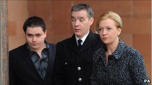 Pc David Rathband arrives at court with his wife and son