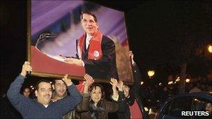Tunisians celebrating the overthrow of President Ben Ali - 13 February 2011