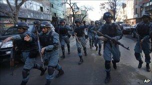 Afghan policemen arrive near the site of suicide bombing in Kabul, Afghanistan, Monday, Feb, 14, 2011