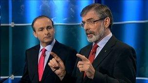 Fianna Fail leader Micheal Martin (L) and Sinn Fein President Gerry Adams