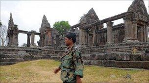 A Cambodian soldier walks past the Preah Vhear temple
