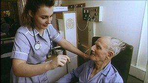 a nurse attending to an elderly patient