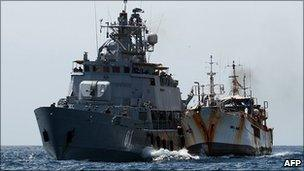 A picture taken on 10 February 2011 and released by the EU Navfor shows the EU Navfor warship FNS Pohjanmaa alongside fishing vessel Golden Wave