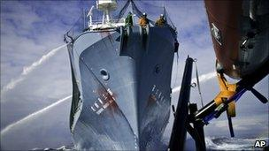 Japanese whaling ship Yushin Maru No 3 approaches the Sea Shepherd's high-speed vessel during their encounter on 4 Feb in Antarctica's Southern Ocean (image released by Sea Shepherd Conservation Society)