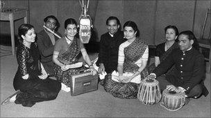 Picture shows Roshan, Shirin and Khurshid Vajifdar (foreground), three sisters who gave a song recital in the BBC Hindi Service to India; with them are (l-r) Sushil Das Gupta (flute), Krishna Kutty, S. Khanna, compere of the programme and Krishna Pennikar (tabla). 1952