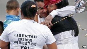 Former hostage Marcos Baquero, centre top, embraces his wife Olga Lucia Tao, right, after he was released by the Revolutionary Armed Forces of Colombia, Farc, in Villavicencio, Colombia, 9 February 2011