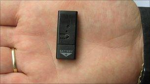 Small listening device in the palm of a hand