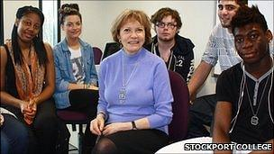 Baroness Bakewell surrounded by Stockport College students