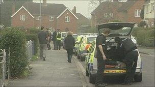 Police and passers-by during operation
