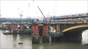 Blackfriars station under construction, showing the piers of the first Blackfriars Railway Bridge