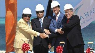 Executives from Export-Import Bank of China and Baha Mar, as well as the Bahamian Deputy Prime Minister.
