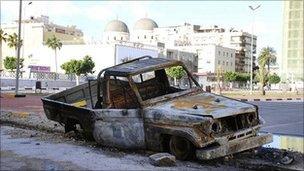Burnt out car in Benghazi, Libya