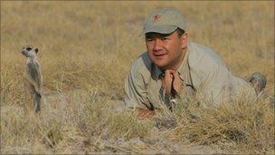 Jose Cortes looking at a meerkat