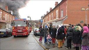 Neighbours look at the fire in Stratford Road