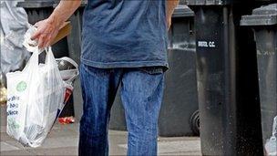 Man carrying bag of rubbish