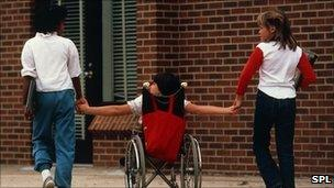 Girl in wheelchair with other children