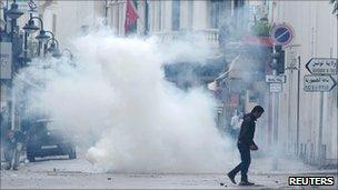 Anti-government protesters clash with riot police in central Tunis