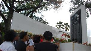 People looking at the Caracazo memorial