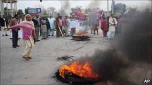 People from Pakistan's Christian community burn tyres in protest against the killing of Shahbaz Bhatti in Islamabad, Pakistan: 3 March, 2011.