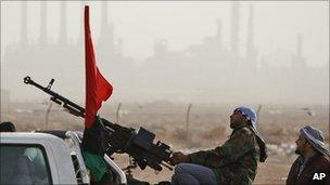 Anti-Gaddafi fighters man a heavy machine gun mounted on a pick-up truck in Ras Lanuf, 5 March.