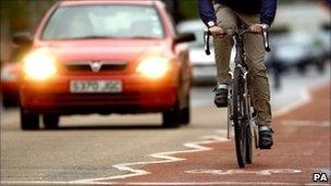 A cyclist rides on a bike lane