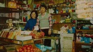 Sunhee and SeoJun Kim in their grocery store (Image courtesy of Ronald Kim)