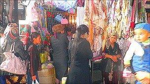 Customers at Karasu market, on the border between Kyrgyzstan and Uzbekistan