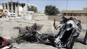 Destroyed car in front of the provincial council building of Tikrit, Iraq, 30 March 2011