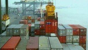 Containers being loaded on to ship