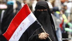 Woman holds a flag at an anti-government rally outside Sanaa University in Yemen on 7/4/11