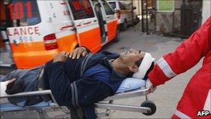 Man carried into al-Najar hospital, Rafah - 7 April