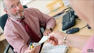 doctor handing over a prescription