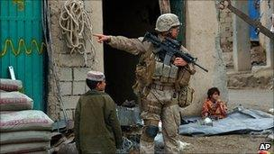 File picture of US soldier on patrol in the main bazaar in Sangin