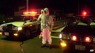 Workers in radiation suits after the 1999 Tokaimura incident