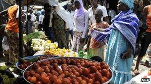 People walks in a market of the south Abidjan popular district of Koumassi on 12 April 2011