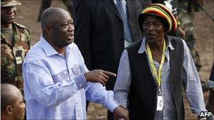 Alpha Blondy (R) and Laurent Gbagbo (L) together at a reconciliation concert of Alpha Blondy's in Ivory Coast in 2007. Photo by Kambou Sia/AFP/Getty Images