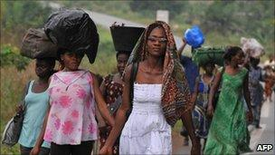Families flee from the Abobo district of Abidjan on February 23, 2011. Photo by Issouf Sanogo/AFP/Getty Images