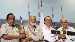 Scientists celebrate the success of the launching
