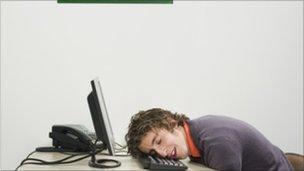 Man napping at desk