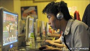 A man plays online games in Beijing