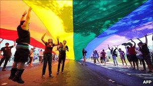 People take part in the 2nd Gay Parade Against Homophobia in Brasilia on 18 May 2011