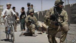 US. soldiers take position near the scene of an explosion in Kandahar south of Kabul, Afghanistan on Sunday, May 22, 2011