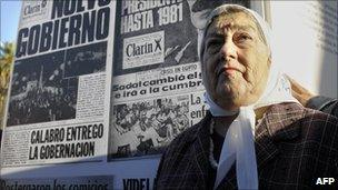Hebe de Bonafini, president of the Madres de Plaza de Mayo, poses next to a banner with the frontpages of Clarin newspaper published during the last Argentine dictatorship (1976-1983), at Plaza de Mayo square in Buenos Aires on 29 April, 2010.