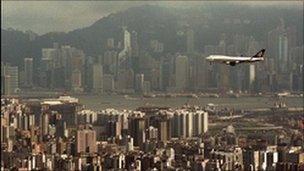 An aircraft flies over Hong Kong's Victoria Habor before landing in Kai Tak International Airport in Hong Kong