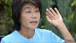 Japanese citizen from Tokyo, Makiko Iwafuchi, 49, gestures during a news conference in Kathmandu June 10, 2011