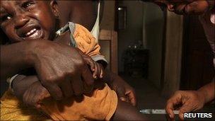 Child in Sierra Leone receiving a vaccine